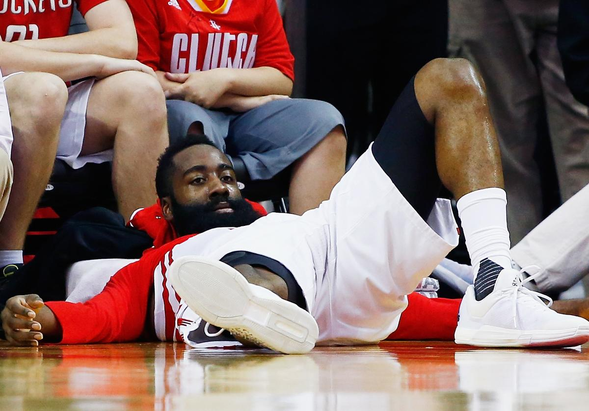 James Harden #13 of the Houston Rockets waits near the bench during their game against the Memphis Grizzlies at the Toyota Center on March 14, 2016 in Houston, Texas.