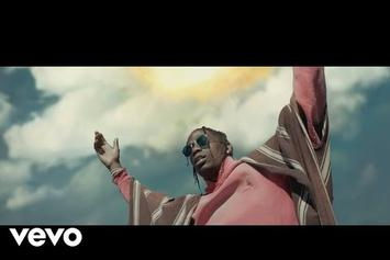 "Travis Scott Drops The ""Stop Trying To Be God"" Music Video"