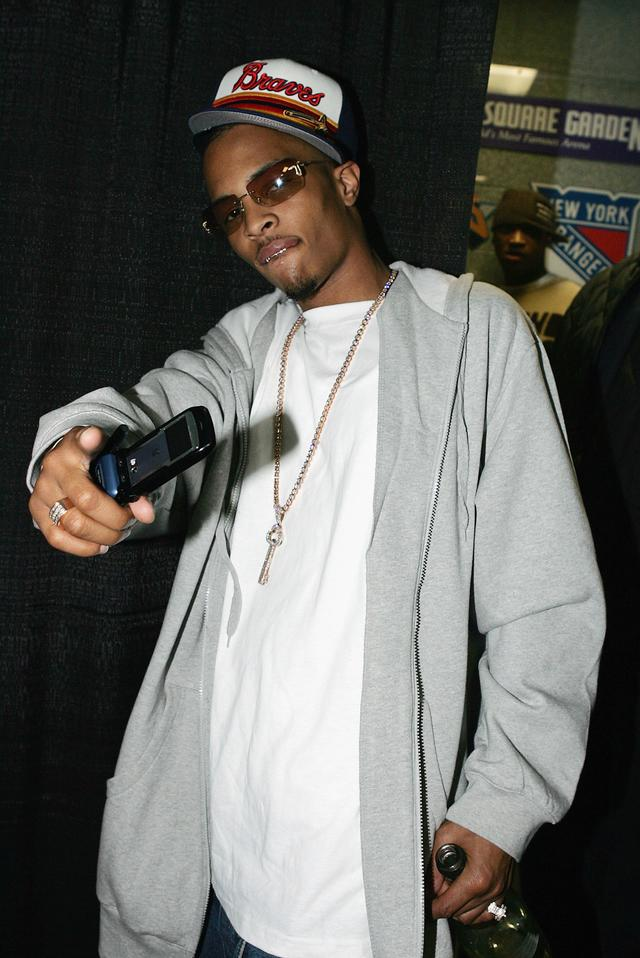 T.I. with an old school flip phone