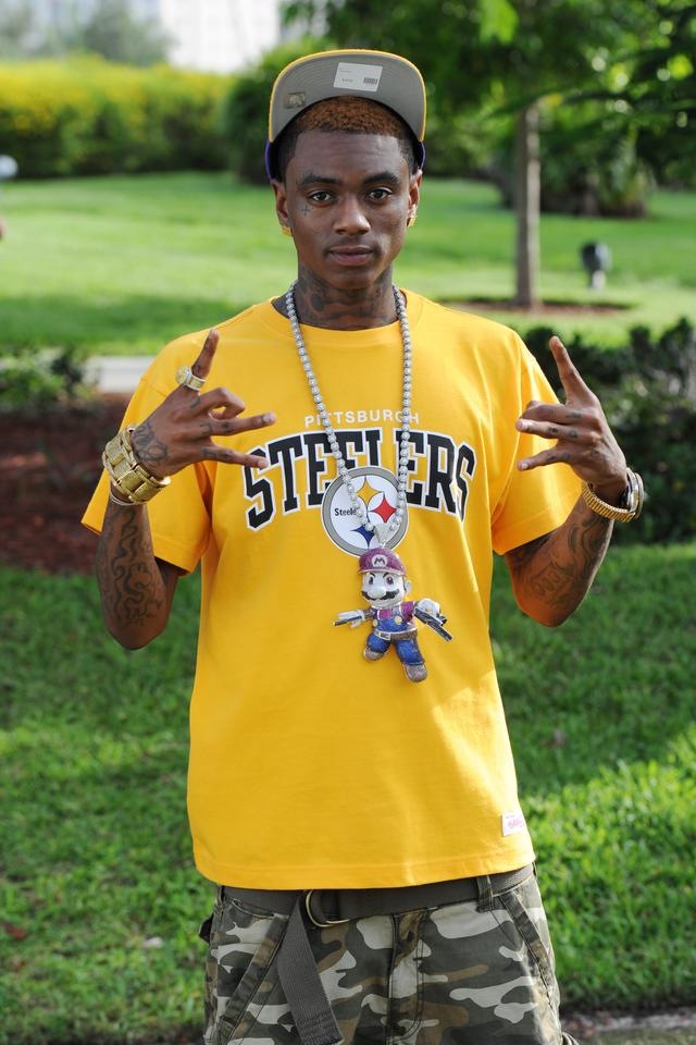 Soulja Boy wearing his mario chain