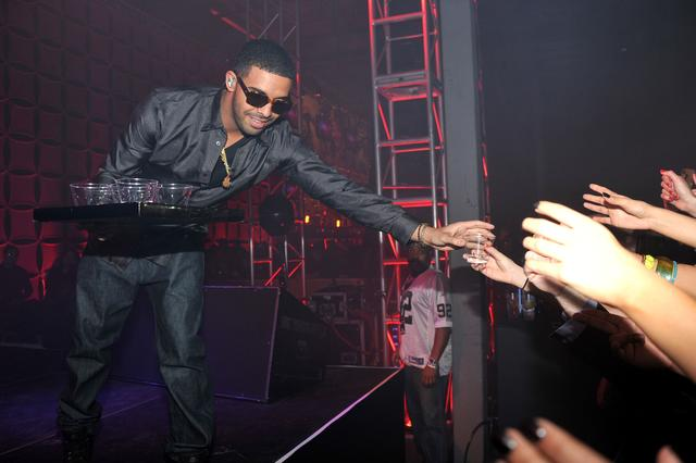 Drake handing out drinks in 2012