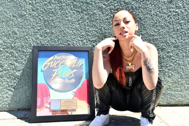 "Bhad Bhabie poses with her plaque for ""Gucci Flip Flops"""